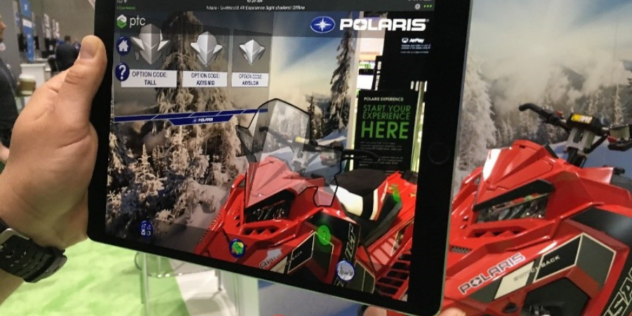 Augmented reality overlays multiple windscreen models over scene with snowmobile.