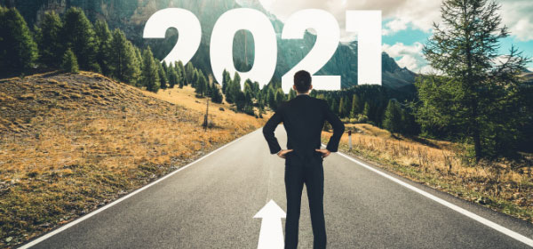 Man looks down mountain road to 2021