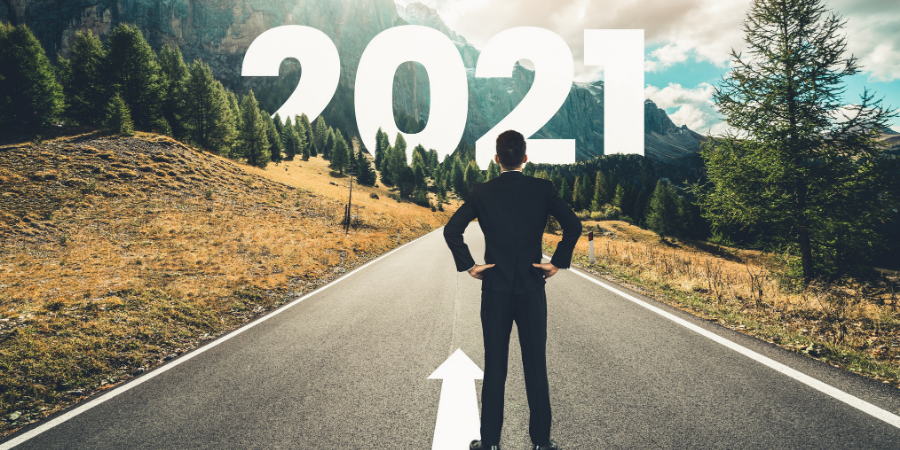 Man looks down mountain road to 2021.