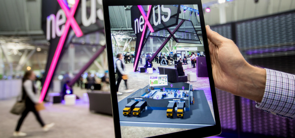 An augmented reality experience shows digital distribution center on physical show floor.