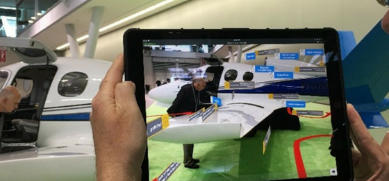 Augmented reality: Data and inspection path overlaid on camera image of airplane