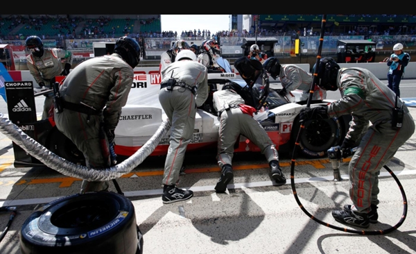 Pit crew works on car