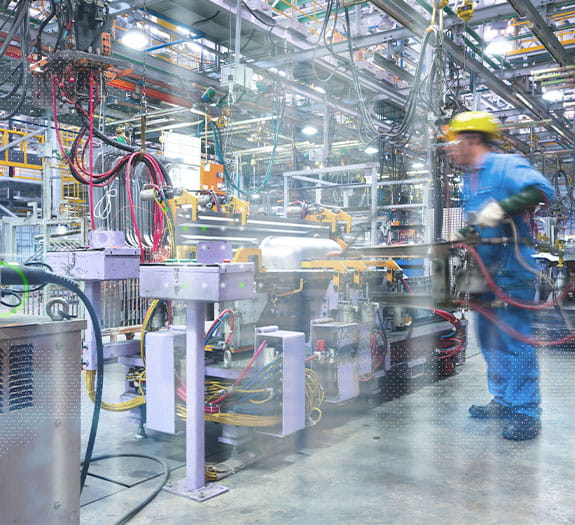 manufacturing employee observing factory machinery