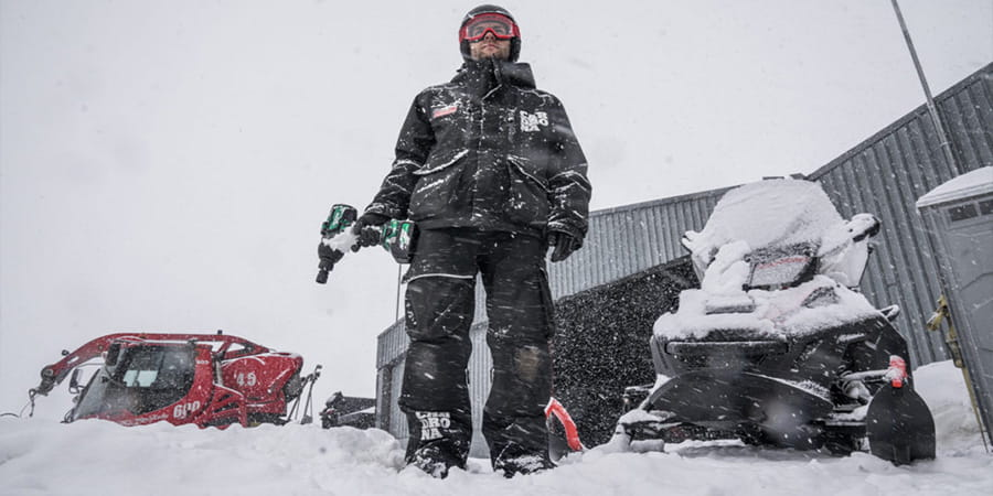 Service technician in winter elements uses HiKOKI Power Tools.